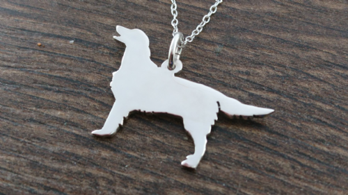 Flatcoat retriever dog pendant sterling silver handmade by saw piercing Caroline Howlett Design